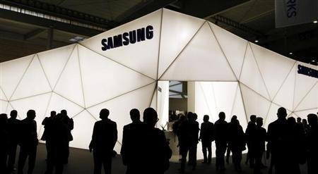 Visitors are seen in front of Samsung stand during the Mobile World Congress at Barcelona