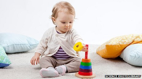 _70276250_c0171492-infant_playing_indoors-spl
