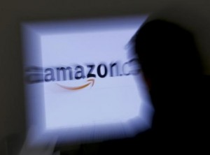 A zoomed illustration image of a man looking at a computer monitor showing the logo of Amazon is seen in Vienna