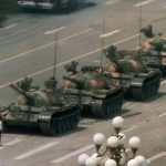 "下載自路透 A Chinese man stands alone to block a line of tanks heading east on Beijing's Cangan Blvd. in Tiananmen Square on June 5, 1989.  The man, calling for an end to the recent violence and bloodshed against pro-democracy demonstrators, was pulled away by bystanders, and the tanks continued on their way.  The Chinese government crushed a student-led demonstration for democratic reform and against government corruption, killing hundreds, or perhaps thousands of demonstrators in the strongest anti-government protest since the 1949 revolution. Ironically, the name Tiananmen means ""Gate of Heavenly Peace"". (AP Photo/Jeff Widener)"