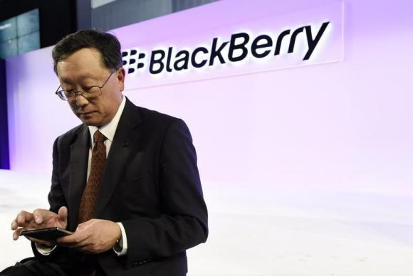 BlackBerry Chief Executive John Chen uses a Passport smartphone following the official launch event in Toronto