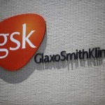 The logo of GlaxoSmithKline is seen on its office building in Shanghai