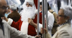 Man Wearing Santa Costume on Subway