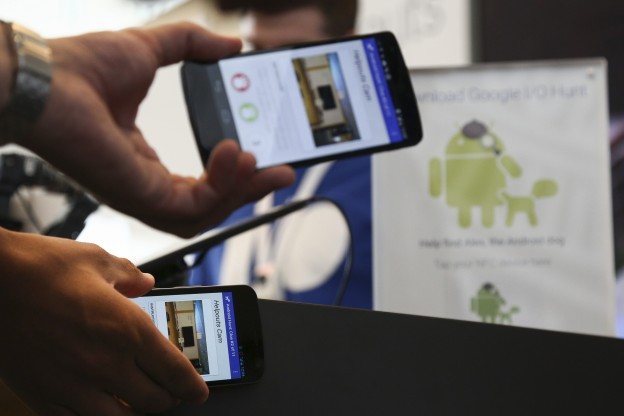 Attendees play a check-in game to win prizes by tapping their NFC-enabled Android smartphones at the Google I/O developers conference in San Francisco