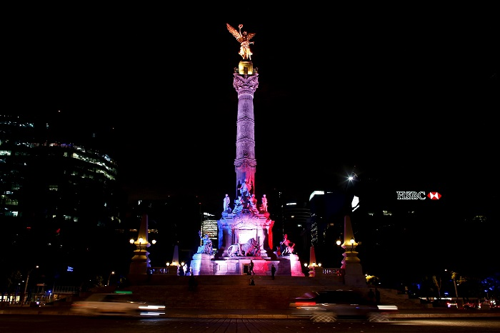 Angel de la Independencia monument is lit up in blue, white and red, the colors of the French flag, following the Paris terror attacks, in Mexico City