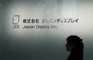 達志影像不得重複使用!!! The logo of Japan Display Inc is seen at the company's new production line for LCD panels in its factory in Mobara, Chiba prefecture, June 3, 2013. Japan Display, which supplies panels to smartphone and tablet makers, plans to invest a total of 200 billion yen ($2 billion) to ramp up production at the plant, according to their news release. REUTERS/Toru Hanai (JAPAN - Tags: BUSINESS LOGO) - RTX109TK