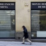 A man walks in front of the Monte dei Paschi bank in Siena, central Italy, January 29, 2016. Merger talks between Italian cooperative lenders Banco Popolare and Banca Popolare di Milano (BPM) took a big step forward on Thursday when Rome backed a tie-up. The two banks are at an advanced stage in merger talks and a combination would create Italy's third biggest lender by assets, just ahead of Monte dei Paschi di Siena. If successful, it would likely be the first merger since a reform of large cooperative lenders last year to encourage consolidation and strengthen Italy's fragmented banking system and could pave the way for a parallel deal between UBI, which had courted BPM, and Monte dei Paschi di Siena. REUTERS/Max Rossi - RTX24K80