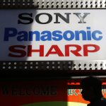下載自路透 A man walks past logos of Japan's technology firms Sony Corp, Panasonic Corp and Sharp Corp at the Akihabara electronics store district in Tokyo October 31, 2013. Sony Corp cut its full-year profit targets and posted a net loss for the September quarter as its struggling TV operation fell back into the red, highlighting the difficulties it faces restoring its electronic hardware operation to profit. Japan's consumer electronics makers including Panasonic Corp and Toshiba Corp have been hobbled by losses from their TV operations, hit by stiff competition from Asian rivals. REUTERS/Toru Hanai (JAPAN - Tags: BUSINESS) - RTX14UUG