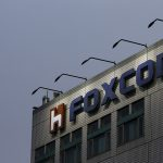 下載自路透 The logo of Foxconn, the trading name of Hon Hai Precision Industry, is seen on top of the company's headquarters in New Taipei City, Taiwan March 29, 2016. REUTERS/Tyrone Siu/File Photo     TPX IMAGES OF THE DAY      - RTX2HIRH