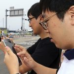 下載自美聯社 HOLD FOR USE WITH STORY SLUGGED SOUTH KOREA POKEMON GO BY YOUKYUNG LEE, In this July 13, 2016 photo, Two South Koreans play the Pokemon Go game with mobile phones in Sokcho, South Korea. The seaside South Korean city of Sokcho is enjoying a surge of visitors who are wandering the streets at all hours as they look at their smartphones. Why? It appears to be the only place in the country where Pokemon Go players can chase the mobile game's virtual monsters.(Lee Jong-hun/Yonhap via AP) KOREA OUT