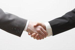 businessperson shake hands