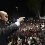 下載自美聯社 Turkey's President Recep Tayyip Erdogan addresses his supporters gathered in front of his residence in Istanbul, early Tuesday, July 19, 2016. Turkey's Interior Ministry has fired nearly 9,000 police officers, bureaucrats and others and detained thousands of suspected plotters following a foiled coup against the government, Turkey's state-run news agency reported Monday. (Kayhan Ozer/Pool Photo via AP)