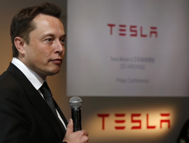 Tesla Motors Inc Chief Executive Elon Musk speaks during a news conference in Tokyo September 8, 2014. Musk said on Monday that he would not be surprised if there was a significant deal with Toyota Motor Corp in the next two to three years, though there were no definitive plans.   REUTERS/Toru Hanai (JAPAN - Tags: BUSINESS TRANSPORT) - RTR45C8R