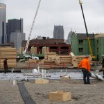 下載自路透 Construction is seen on a new housing development along the riverfront in Detroit, Michigan, December 9, 2015. A year after the city exited the biggest-ever U.S. municipal bankruptcy, a plan to demolish half of its nearly 80,000 blighted or deteriorating structures -- nearly one in three city buildings -- is showing some signs of success. Photo taken December 9, 2015. To match Feature USA-DETROIT/DEMOLITION REUTERS/Rebecca Cook - RTX1YPOA