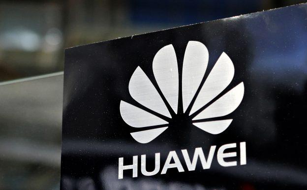 下載自路透 A Huawei logo is seen above the company's exhibition pavilion during the CommunicAsia information and communications technology trade show in Singapore June 19, 2012. REUTERS/Tim Chong (SINGAPORE - Tags: BUSINESS LOGO SCIENCE TECHNOLOGY) - RTR33UTB