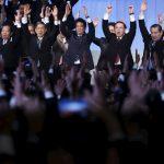 """下載自路透 Japan's Prime Minister Shinzo Abe (C) shouts """"Banzai!"""" (cheers) as he throws his hands in the air with members of the ruling Liberal Democratic Party (LDP) during the annual party convention in Tokyo, Japan, March 13, 2016. REUTERS/Yuya Shino      TPX IMAGES OF THE DAY      - RTX28WEK"""