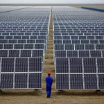 下載自路透 A worker inspects solar panels at a solar Dunhuang, 950km (590 miles) northwest of Lanzhou, Gansu Province September 16, 2013. China is pumping investment into wind power, which is more cost-competitive than solar energy and partly able to compete with coal and gas. China is the world's biggest producer of CO2 emissions, but is also the world's leading generator of renewable electricity. Environmental issues will be under the spotlight during a working group of the Intergovernmental Panel on Climate Change, which will meet in Stockholm from September 23-26. REUTERS/Carlos Barria (CHINA - Tags: ENERGY BUSINESS ENVIRONMENT) - RTX13UEF