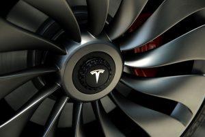下載自路透 A wheel of a  prototype of the Tesla Model 3 on display in front of the factory during a media tour of the Tesla Gigafactory, which will produce batteries for the electric carmaker in Sparks, Nevada, U.S. July 26, 2016.  REUTERS/James Glover II - RTSJT7R