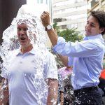 下載自路透 Liberal leader Justin Trudeau (R) dumps a bucket of ice water onto Liberal MP Sean Casey for the ALS ice bucket challenge during a break in the Federal Liberal summer caucus meetings in Edmonton August 19, 2014.  REUTERS/Dan Riedlhuber/File Photo - RTSJWKM