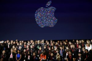 A group of young developers stand for a group photo on stage during the Apple World Wide Developers Conference in San Francisco, California, U.S., June 13, 2016. REUTERS/Stephen Lam  TPX IMAGES OF THE DAY      - RTX2G1OT