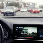 下載自路透 The screen in Delphi's automated vehicle shows the car stopping on its own after communicating with a stop light at an intersection at the Consumer Electronics Show in Las Vegas, January 5, 2016. Using advanced software and hardware, Delphi's vehicle can communicate with streets, signs, traffic lights, other cars and even pedestrians according to the company. REUTERS/Rick Wilking - RTX216DL