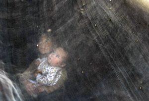 下載自路透 Nenets children rest in a Nenets' traditional tent on the Yamal peninsula, north of the polar circle, August 4, 2009. The Nenets tribespeople of Russia's frozen Yamal peninsula have survived the age of the Tsars, the Bolshevik revolution and the chaotic 1990s, but now confront their biggest challenge -- under their fur-bundled feet is enough gas to heat the world for five years. Picture taken August 4, 2009. TO MATCH FEATURE RUSSIA-YAMAL/NENETS REUTERS/Denis Sinyakov (RUSSIA ENVIRONMENT SOCIETY IMAGES OF THE DAY) - RTXPE6P