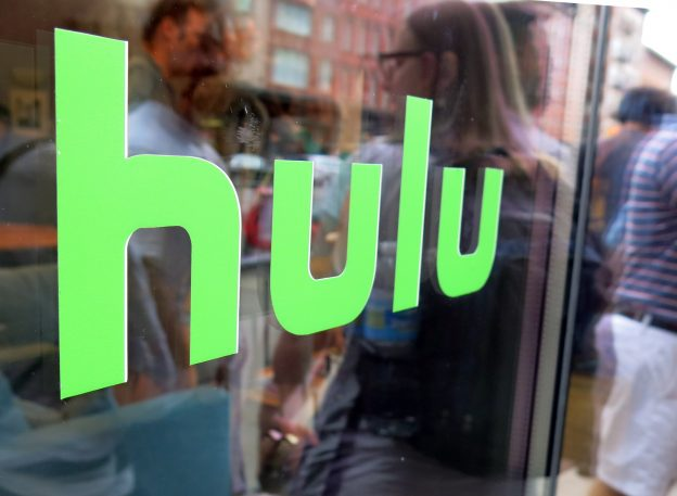 FILE - This June 27, 2015, file photo, shows the Hulu logo on a window at the Milk Studios space in New York. Hulu said Monday, Aug. 8, 2016, that the company is dropping the free TV episodes that it was initially known for as it works on launching a skinny bundle of streaming TV. (AP Photo/Dan Goodman, File)