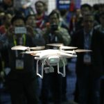 下載自美聯社 FILE- In this Jan. 7, 2016, file photo, a drone hovers at a booth during CES International, Thursday, Jan. 7, 2016, in Las Vegas. The recent announcement of federal aviation rules specifically designed for small drone aircraft is giving a lift to researchers and a Nevada program set up to foster development of commercial unmanned aerial vehicles. (AP Photo/John Locher, File)