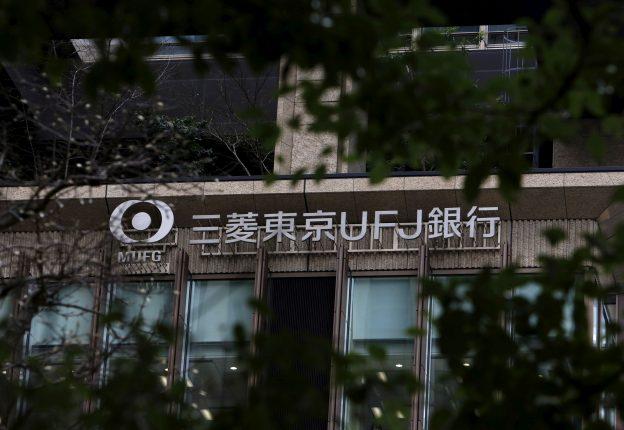 下載自路透 A signboard of the Mitsubishi UFJ Financial Group's bank of Tokyo-Mitsubishi UFJ is seen between trees outside a building in Tokyo, Japan, February 1, 2016.   REUTERS/Yuya Shino/File Photo         GLOBAL BUSINESS WEEK AHEAD PACKAGE - SEARCH 'BUSINESS WEEK AHEAD MAY 16'  FOR ALL IMAGES - RTSEFTL