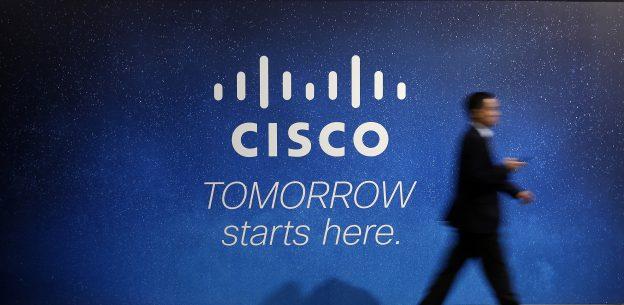 下載自路透 A visitor walks past a Cisco advertising panel at the Mobile World Congress in Barcelona February 27, 2014. REUTERS/Albert Gea/File Photo - RTX2LDV0
