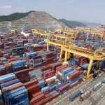 Hanjin Shipping's container terminal is seen at the Busan New Port in Busan, about 420 km (261 miles) southeast of Seoul August 8, 2013. South Korean export growth in August picked up more than expected to the fastest in seven months, data showed on September 1, 2013, suggesting gathering momentum for the trade-dependent economy amid signs of stabilisation in advanced countries. Picture taken August 8, 2013. REUTERS/Lee Jae-Won (SOUTH KOREA - Tags: BUSINESS MARITIME) - RTX133AS