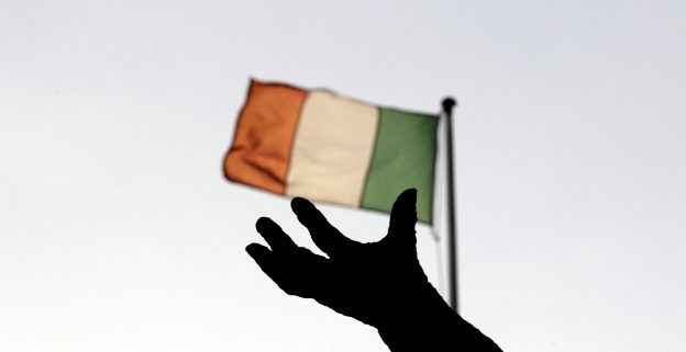 Ireland's national flag flies above a statue on O'Connell Street in Dublin in this December 5, 2011 file photo. REUTERS/Cathal McNaughton/File Photo - RTX2NQ7G