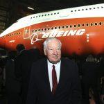 """下載自路透 Joe Sutter, Boeing's chief engineer on the original jumbo, and known as the """"father of the 747."""" walks in front of a newly unveiled 747-8 jumbo passenger jet at the company's Everett, Washington commercial airplane manufacturing facility, February 13, 2011. Boeing Co rolled out a new jumbo jet on Sunday, hoping to relive the glamor of the birth of the 747 over 40 years ago and use it to boost slow sales. The 747-8 Intercontinental will seat 467 passengers, 51 more than the current version of the 747, and burn less fuel while offering passengers more comfort, the U.S. planemaker says. REUTERS/Anthony Bolante (UNITED STATES - Tags: TRANSPORT BUSINESS SOCIETY) - RTR2IK0X"""