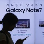 下載自美聯社 A woman walks by an advertisement of Samsung Electronics Galaxy Note 7 smartphone at the company's showroom in Seoul, South Korea, Friday, Sept. 2, 2016. Samsung Electronics recalled all of its Galaxy Note 7 smartphones on Friday after its investigation found batteries of some of the flagship gadgets caused the phone to explode or to catch fire. (AP Photo/Ahn Young-joon)