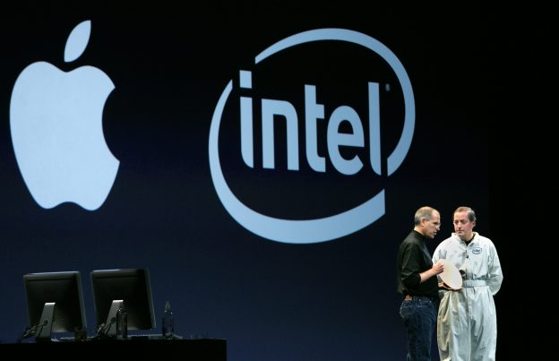 Apple chief executive officer Steve Jobs (L) holds an Intel silicon wafer as he talks to Intel chief executive officer Paul Otellini during Jobs' keynote address at the Macworld Conference and Expo in San Francisco, January 10, 2006. Apple Computer Inc. On Tuesday introduced new Intel-powered desktop and notebook computers and said its wildly popular iPods helped drive a 63 percent jump in holiday quarter sales, sending shares up more than 4 percent. Apple also introduced new computers based on Intel Corp. chips, the first to result from its decision to switch from [IBM PowerPC] chips it had used for years. - RTXO40C