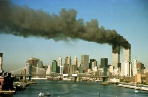 下載自路透 A September 11, 2001 file photo shows the towers of New York's World Trade Center pour smoke shortly after being struck by hijacked commercial aircraft. New York City plans to mark the third anniversary of the attacks on the trade center with an observance at the site on September 11 with parents and grandparents of victims reading their names. REUTERS/Brad Rickerby  JDP - RTRAFTD