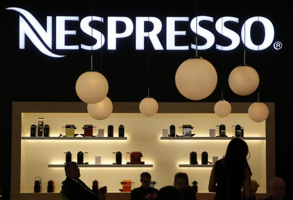 下載自路透 Visitors take a pause at the booth of Nespresso at the IFA consumer technology fair in Berlin, September 5, 2014. REUTERS/Fabrizio Bensch (GERMANY - Tags: BUSINESS FOOD SCIENCE TECHNOLOGY) - RTR45279