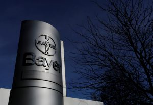 The logo of Bayer AG is pictured at the Bayer Healthcare subgroup production plant in Wuppertal, Germany February 24, 2014. REUTERS/Ina Fassbender/File Photo - RTSNNWX