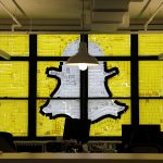 "An image of the Snapchat logo created with Post-it notes is seen in the windows of Havas Worldwide at 200 Hudson Street in lower Manhattan, New York, U.S., May 18, 2016, where advertising agencies and other companies have started what is being called a ""Post-it note war"" with employees creating colorful images in their windows with Post-it notes. REUTERS/Mike Segar     TPX IMAGES OF THE DAY      - RTSEXHO"