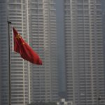 下載自路透 A Chinese flag is seen in front of the financial district of Pudong in Shanghai, China, January 19, 2016. China's economic growth eased to 6.8 percent in the fourth quarter from a year earlier, matching expectations but still the slowest since the global financial crisis, putting pressure on policymakers to roll out more support measures as fears of a sharper slowdown pummel global financial markets. REUTERS/Aly Song - RTX22ZM2