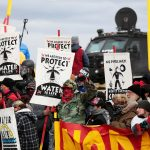 下載自路透 Dakota Access Pipeline protesters square off against police near the Standing Rock Reservation and the pipeline route outside the little town of Saint Anthony, North Dakota, U.S., October 5, 2016. REUTERS/Terray Sylvester/File Photo - RTSRZWU