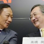 Terry Gou (L), founder and Chairman of Taiwan's Foxconn, formally known as Hon Hai Precision Industry, exchanges smiles with Japan's Sharp Corp Chief Executive Kozo Takahashi during their joint news conference in Sakai, western Japan, in this photo taken by Kyodo April 2, 2016.        Mandatory credit REUTERS/Kyodo ATTENTION EDITORS - THIS IMAGE HAS BEEN SUPPLIED BY A THIRD PARTY. FOR EDITORIAL USE ONLY. NOT FOR SALE FOR MARKETING OR ADVERTISING CAMPAIGNS. MANDATORY CREDIT. JAPAN OUT. NO COMMERCIAL OR EDITORIAL SALES IN JAPAN.      TPX IMAGES OF THE DAY      - RTSD8IC