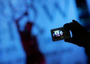 下載自路透 A visitor takes pictures of an adult film actress during the Eros Show in the Bulgarian capital Sofia April 2, 2008. The show, which includes exhibitions of sex products, latest erotic films and live erotic performances, will run for four days.  REUTERS/Stoyan Nenov (BULGARIA) - RTR1Z1G1