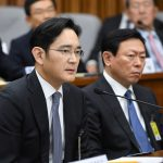 Samsung Group's heir-apparent Lee Jae-yong (L) answers a question as Lotte Group Chairman Shin Dong-Bin (R) listens during a parliamentary probe into a scandal engulfing President Park Geun-Hye at the National Assembly in Seoul on December 6, 2016. The publicity-shy heads of South Korea's largest conglomerates faced their worst nightmare on December 6, as they were publicly grilled about possible corrupt practises before an audience of millions.  REUTERS/Jung Yeon-Je/Pool? - RTSUTR1
