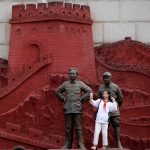 "下載自路透 A girl takes a selfie with statues depicting late Chinese chairman Mao Zedong (L) and former general Zhu De during the War of Resistance against Japan, at Jianchuan Museum Cluster in Anren, Sichuan Province, China, May 13, 2016. Tucked away in southwestern China's Sichuan province, a private collector stands virtually alone in exhibiting relics from the 1966-1976 Cultural Revolution. Monday marks the 50th anniversary of the start of the political movement, with no official commemorations planned. Official records whitewash the details of both periods, but admit that Mao made major mistakes. REUTERS/Kim Kyung-Hoon FOR EDITORIAL USE ONLY. SEARCH ""CULTURAL KIM"" FOR THIS STORY. SEARCH ""THE WIDER IMAGE"" FOR ALL STORIES TPX IMAGES OF THE DAY? - RTSEBUT"