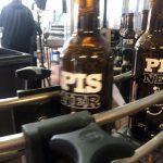 下載自路透 The Pisner Beer is being labeled at Norrebro Bryghus in Hedehusene, Denmark, May 4, 2017. Picture taken May 4, 2017. REUTERS/Julie Astrid Thomsen - RTS159W5
