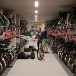 下載自路透社 Two cyclists parks their bikes in the world's largest bike parking garage in Utrecht, Netherlands August 21 , 2017. REUTERS/Michael Kooren - RTS1CMNO