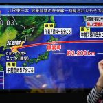 下載自路透 A passerby looks at a TV screen reporting news about North Korea's missile launch in Tokyo, Japan September 15, 2017.  REUTERS/Issei Kato - RC1354081390