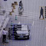 下載自路透社 SenseTime surveillance software identifying details about people and vehicles runs as a demonstration at the company's office in Beijing, China, October 11, 2017. Picture taken October 11, 2017.  REUTERS/Thomas Peter - RC1D8567EE20