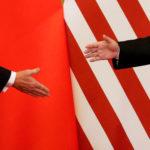 """下載自路透社 U.S. President Donald Trump and China's President Xi Jinping shake hands after making joint statements at the Great Hall of the People in Beijing, China, November 9, 2017. Damir Sagolj: """"It's one of those """"how to make a better or at least different shot when two presidents shake hands several times a day, several days in row"""". If I'm not mistaken in calculation, presidents Xi Jinping of China and Donald Trump of the U.S. shook their hands at least six times in events I covered during Trump's recent visit to China. I would imagine there were some more handshakes I haven't seen but other photographers did. And they all look similar - two big men, smiling and heartily greeting each other until everyone gets their shot. But then there is always something that can make it special - in this case the background made of U.S. and Chinese flags. They shook hands twice in front of it, and the first time it didn't work for me. The second time I positioned myself lower and centrally, and used the longest lens I have to capture only hands reaching for a handshake."""" REUTERS/Damir Sagolj/File Photo  SEARCH """"POY TRUMP"""" FOR THIS STORY. SEARCH """"REUTERS POY"""" FOR ALL BEST OF 2017 PACKAGES.    TPX IMAGES OF THE DAY - RC1B1E5EF340"""